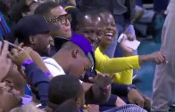 Cam Newton hits a dab after LeBron James throws it down