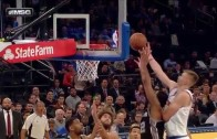 Kristaps Porzingis rises over LaMarcus Aldridge for the putback slam
