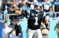 Too Cute: Cam Newton takes throwing advice from a young kid