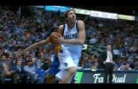 Dirk Nowitzki throws down the rare slam dunk