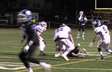 High school football referee trucks receiver forcing a fumble