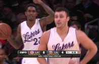 Lakers player Larry Nance tips the ball into his own basket