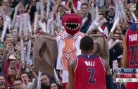 Toronto Raptors mascot does his best to distract John Wall