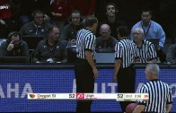Oregon State player Jarmal Reid trips a referee