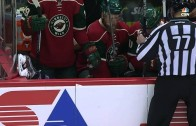 Washington Captials' Tom Wilson gets decked into the bench