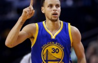 Stephen Curry banks in the buzzer beater 3 ball