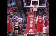 Female Rockets fans flash Ryan Anderson during free throws
