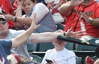 Hero dad saves his son from flying baseball bat