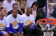 Kobe Bryant gives away signed sneakers to young fan