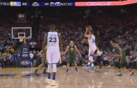 Stephen Curry banks in half court shot