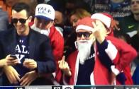 Yale fan dressed as Santa flips middle fingers at Duke