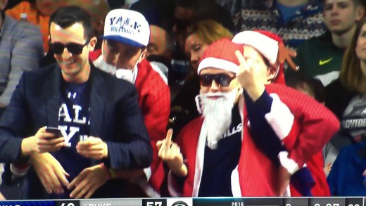 Yale fan dressed as Santa flips middle fingers at Duke