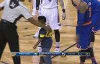 Young kid runs on the court to hug Carmelo Anthony
