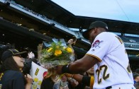 Fan gives Andrew McCutchen a bouquet of flowers before the game