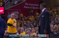 Dwane Casey goes at it with a Cavs fan on the sidelines