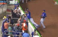 Cubs' Javier Biaz dives into the stands to make the catch