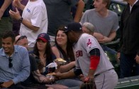 Juan Uribe pretends to go for a fan's hot dog
