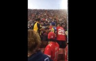 Alternate Angle: Chiefs fan punches Rams fan in the face in front of LAPD