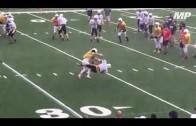 High schooler lays a bone crushing hit in scrimmage