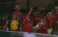 Kole Calhoun leaps to take a home run away from Kyle Seager