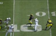 Michigan's Jabril Peppers hurdles Hawaii defender