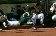 Oakland A's ball boy dives to try and protect A's pitchers