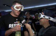 Blue Jays pitcher Joe Biagini pretends champagne bottle is a microphone