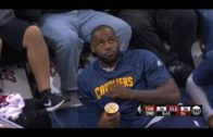 LeBron James eats popcorn court side during pre-season game
