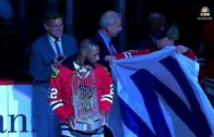 Cubs bring World Series trophy to Blackhawks game