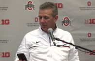 Urban Meyer takes a phone call from his wife during Ohio State's press conference