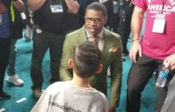 Michael Irvin jokes with a youngster on Super Bowl opening night (FV Exclusive)