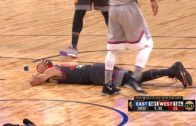 Steph Curry lays down on the court to avoid Giannis Antetokounmpo dunk