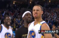 Stephen Curry banks in a deep buzzer beater