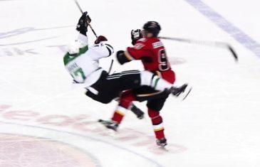 Calgary's Sam Bennett levels Dallas' Devin Shore with a massive hit