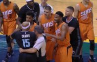 Vince Carter elbows Devin Booker causing a scrum with Phoenix