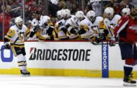 Washington Captials' Tom Wilson gets decked into the bench