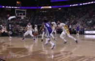 De'Aaron Fox bursts to the rim and finishes over Julius Randle