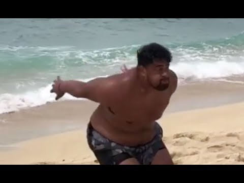 Wisconsin Badgers DT Olive Sagapolu Backflips on the Beach